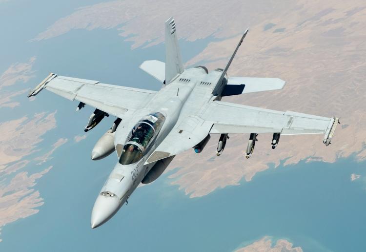 A_Royal_Australian_Air_Force_F-A-18F_Super_Hornet_departs_after_receiving_fuel_from_a_U.S._Air_Force_KC-135_Stratotanker.jpg