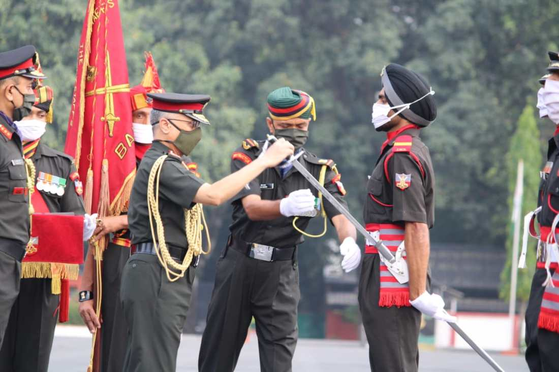 General MM Naravane, PVSM, AVSM, SM, VSM, ADC, Chief Of Army Staff, Reviewing Officer, presenting Sword of Honour to Battalion Under Officer Akashdeep Singh Dhillon.